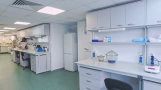 Pharmaceutical laboratory room. Steadyshot of empty pharmacy laboratory. Pharmaceutical laboratory interior. Pharmacy lab working space. Pharmaceutical research laboratory. Science lab