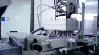 Pharmaceutical manufacturing line. Pharmaceutical packaging line. Close up of pharmacy manufacturing machine. Pharmaceutical plant. Pharmaceutical vials packaging machine. Medicine industry