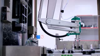 Pharmaceutical production line. Robotic arm of packaging machine at pharmaceutical plant. Industrial equipment. Automated process. Medicine industry. Medicine manufacturing line