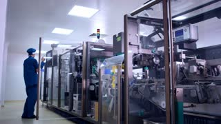 Pharmaceutical production machine. Engineer control medical manufacturing. Medical production line. Medicine manufacturing. Factory worker operating pharmaceutical equipment. Pharmacy industry