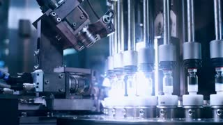 Pharmaceutical quality control of medical vials. Pharmaceutical production line. Pharmaceutical industry. Pharmaceutical manufacturing line at pharmacy factory. Medical ampoules at factory line