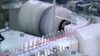 Pharmacy production line at pharmaceutical factory. Medical vials manufacturing line at pharmaceutical plant. Pharmacy products at conveyor line. Pharmaceutical manufacture. Pharmaceutical industry