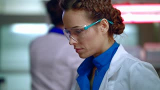 Portrait of female doctor in medical lab. Lab doctor working in research lab. Medical scientist working with laboratory equipment. Face of lab woman working in laboratory. Doctor in medical laboratory