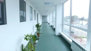 Pov of camera walking lab corridor. Steady cam shot of laboratory corridor. Point of view of walking hospital corridor