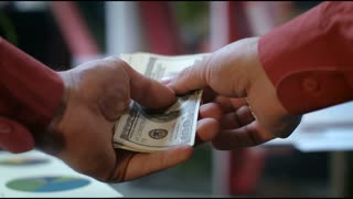 POV view of male hands counting money cash in bank office. Employee counting dollar bills in office. Banking activity. Currency exchange concept. Corporate financial business