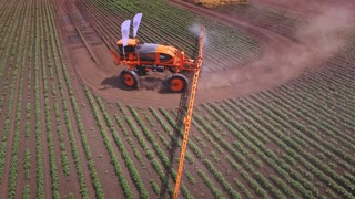 Process irrigation on farming field using agriculture fertilizer. Drone view agriculture fertilizer working on cultivated field. Fertilizer agriculture. Agriculture spraying. Pesticide spraying