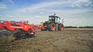 Process plowing farming field. Farming tractor plowing agricultural field. Agriculture machinery plow field