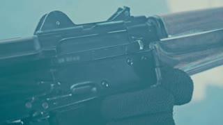 Removing fuse ak 47. Charging machine gun. Close up of charging rifle kalashnikov. Reloading assault kalashnikov rifle