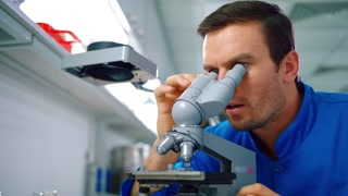 Researcher man working with microscope in lab. Lab doctor doing microscope research. Medical researcher looking microscope. Lab man doing lab research. Scientist doing laboratory microscope research