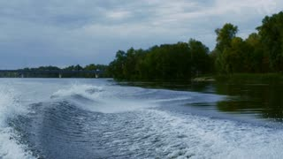 Rider falling from wakeboard into river in slow motion. Sportsman failing. Fall on water. Water sports. Guy riding on waterski falling into water. Extreme lifestyle