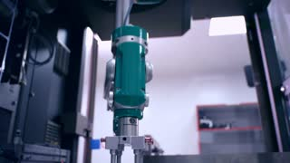 Robot arm at packaging line. Automated process. Factory. Industrial equipment. Modern technology. Pharmaceutical manufacturing line. Packing machine at pharmaceutical plant. Automated production line