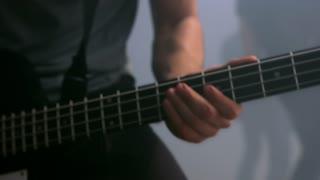 Rock musician plays solo guitar. Close up of rock guitar solo. Closeup of rock guitar player hands. Rock guitarist. Young man playing electric guitar