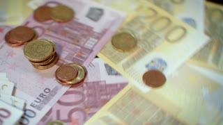 Rotating euro banknotes and coins. Pile of euro currency. Banking and commercial activity. Cash flow statement. Rotating money background. Business success and financial grow. Internet market money