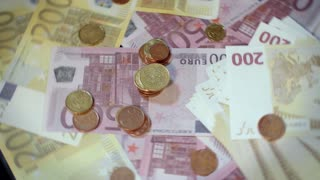 Rotating money background. Euro banknotes and coins on money background. Pile of euro currency. Banking and commercial activity. Cash flow statement. Business success concept and financial grow