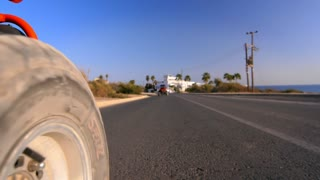 Sand buggy car wheel road. View of asphalt road at level of racing buggy wheel. View from dune buggy going on city road