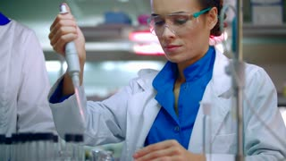 Scientist woman working with chemical reagents. Chemical reaction in lab flask. Female scientist working in laboratory. Woman scientist carrying out laboratory research in research lab