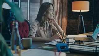 Serious businesswoman doing business data analysis. Working woman analyzing report of business growth. Focused worker analysing report in office. Female employee working at night in home office