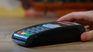Shopping with credit card. Hand with gold credit card swipe through payment terminal. Man buying gift. Banking services of electronic money. Credit card machine for money transaction. Terminal payment