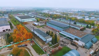 Sky view industrial buildings on manufacturing factory territory. Warehouse buildings on territory industrial plant drone view. Industrial buildings on industrial city aerial view. Aerial landscape