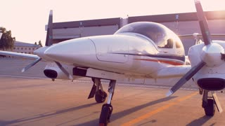 Small airplane parked in airport. Private airplane at airport parking place. Airplane with two propeller engines. Small propeller plane. Private aircraft. Luxury plane. Prop plane parked at airport