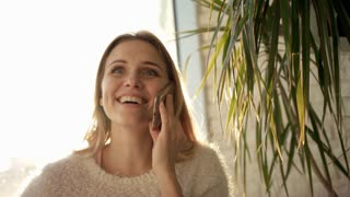 Smiling woman talking on phone. Laughing woman speaking mobile phone. Happy woman have mobile conversation. Portrait of talking woman with smartphone. Happy girl talking mobile. Enjoy life