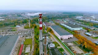 Smoking chimney at industrial factory aerial view. Factory landscape. Industrial factory with boiler pipe sky view. Top view smoking chimney and industrial buildings. Industrial land