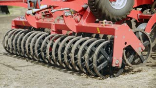 Sowing machine. Close up seeders sowing machine. Farming agriculture. Modern farming equipment for field sowing. Agricultural machinery. Farming industry. Rural farming