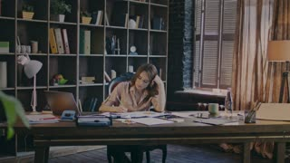 Successful businesswoman focusing on paperwork. Beautiful woman reading documents in cozy office. Business employee reading contract. Female marketer doing market research