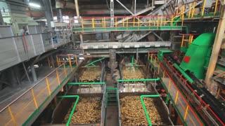 Sugar processing factory machine. Food processing industry. Washing machine at processing factory. Sugar beets washing in factory line. Food processing plant
