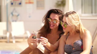 Summer girls showing v sign hand. Sexy woman in sunglasses taking selfie in slow motion. Close up of two woman have fun. Happy women women taking selfie