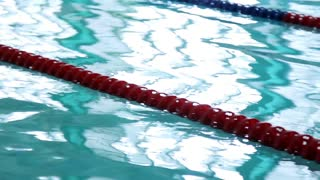 Swimming pool paths. Clear water in swimming pool with race lanes. Empty pathes in swimming pool