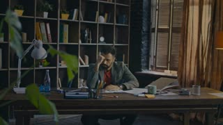 Tired businessman can not concentrate on work. Frustrated businessman in home office. Business man tired at end of day in cozy office. Tired worker in office