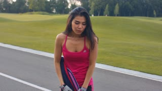 Tired woman after fitness training in park. Tired asian runner. Close up of asian woman after fitness workout outdoor. Exhausted woman breathing after hard training outside