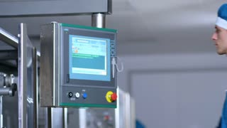 Touch screen technology. Close up of factory worker program touch screen control. Factory employee control screen. Industrial factory control display. Industrial control screen