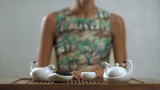 Tradition brewing green tea. Preparation teapot and cup for drinking. Tea ceremony сoncept. Traditional process of tea drinking preparation. Concept of chinese tea process