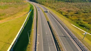 Transport at highway road. Aerial view of highway road. Bird eye view of cars traffic at road. Cars driving over highway. Aerial view of road traffic. Drone view of highway landscape