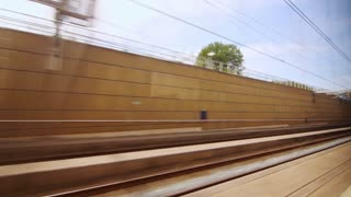 View from the window moving train to railway stations. View from window moving highspeed train on railway platform. Trip on train along platform