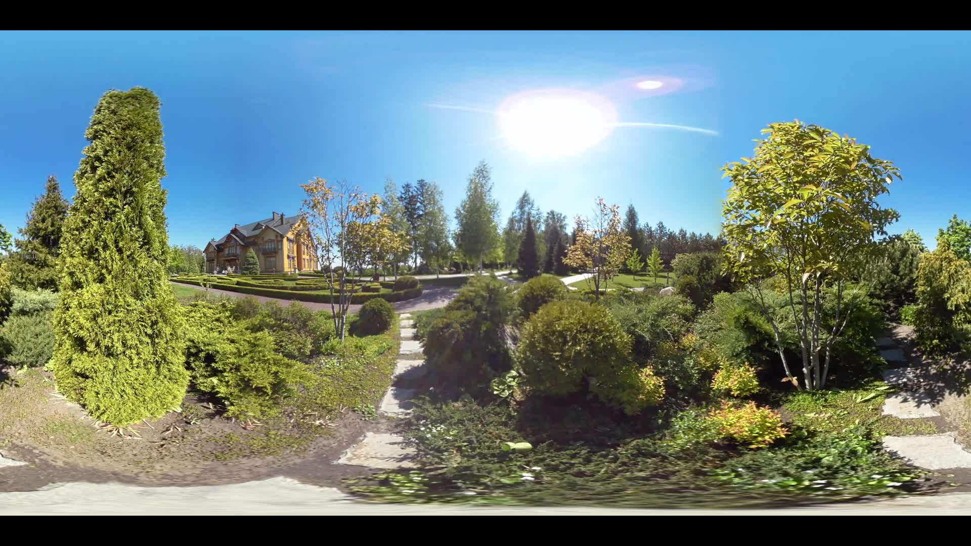Virtual reality of detached house in private garden. Brick house on green trees on summer day 360 video. Brick mansion in summer garden in summer day 360 degrees panorama