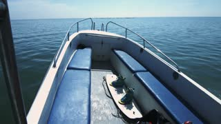 Wakeboard boat with board for water skiing fast floating on sea. Equipment for wakeboarding and waterskiing on floating boat. Extreme water sport concept
