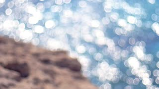 Water sunlight defocus background. Lights on sea background blurred. Bright ocean water. Seascape in bright summer. Shining sun reflecting on sea water. Blurred sea background a hot summer