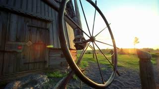 Wheel spinning for start windmill on farm landscape. Close up a spinning wheel of windmill. Wheel for starting a windmill. Windmill farm equipment