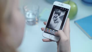Woman check mobile filter for instagram photo. Close up of female hand using instagram filters for manicured hand photo. Instagram hands photo. Iphone photography of nail gel