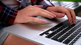 Woman hands typing on laptop keyboard. Close up of female hand on keyboard. Female fingers typing on keyboard. Typing hands on macbook keyboard. Hands typing computer
