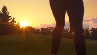 Woman running back at sunset. Young woman running sunset. Fitness woman running outdoors. Real woman running in park at sunset. Fitness workout outdoor. Female runner athlete training outside