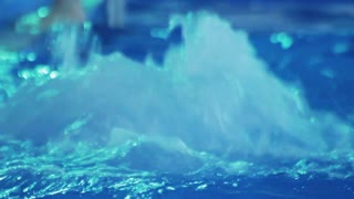 Water splashes in jacuzzi. Rippled water in blue swimming pool. Transparent water in swimming pool. Swimming pool clear water splashes. Jacuzzi clear waters splash enjoyment. Blue water background