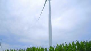 Wind generator. Wind turbine generating wind power. Wind turbine blades rotating on clouds sky background. Alternative energy