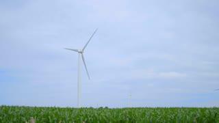 Wind power plant. Wind generators on field. Dolly shot of wind turbines on farm field. Wind turbines landscape. Alternative energy concept. Wind power generation. Wind power resource
