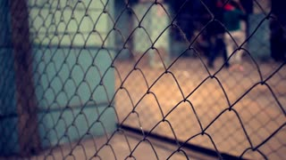 Wire fence. Closeup of steel net. Steel mesh. Security protection barrier in shopping center. Industrial security element. Fence made from steel wire. Net background. Metallic security net