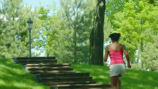 Woman run up stairs in slow motion. Girl running on stairway in park. African woman running up on stairs. Mulatto woman run upstairs. Running woman on stairs. Real girl jogging up stairs outdoor