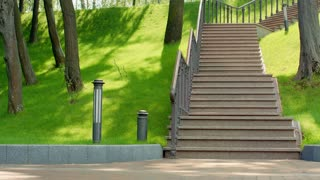 Woman running up stairs in slow motion. Fitness woman running upstairs with dumbbells outdoors. Blonde woman running on staircase at park. Young woman fitness workout. Weight loss exercise